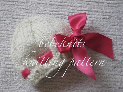 Eyelet Baby Pink Hat Knitting Pattern