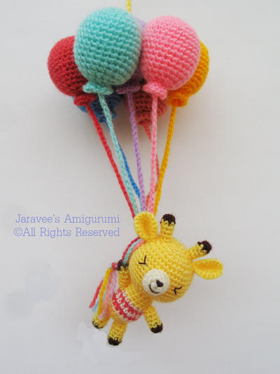 Giraffe and balloons