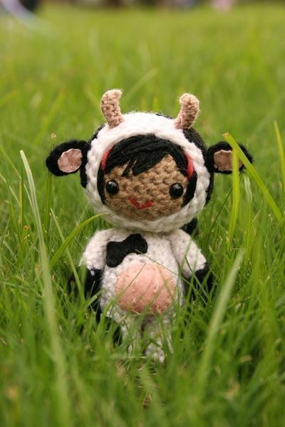 Bess in the cow costume amigurumi doll