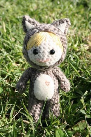 Celia dressed as a cat amigurumi doll
