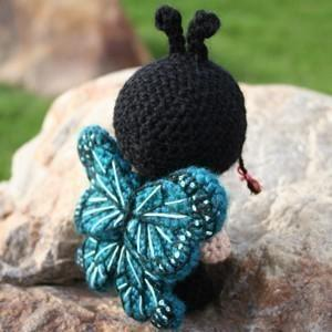 Francisca dressed as a butterfly amigurumi doll