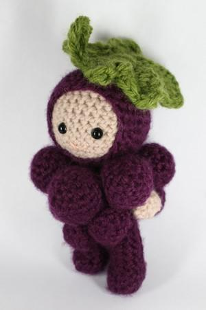 Georgie, an amigurumi grapes boy doll