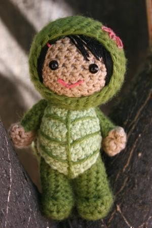 Lucy in a turtle costume amigurumi doll