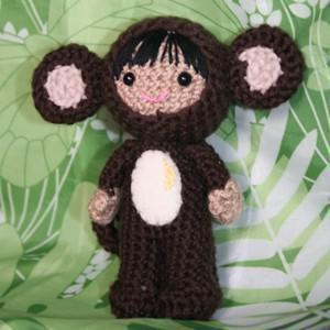 Raquel in a monkey costume amigurumi doll