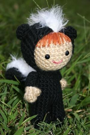 Summer dressed as a skunk amigurumi doll