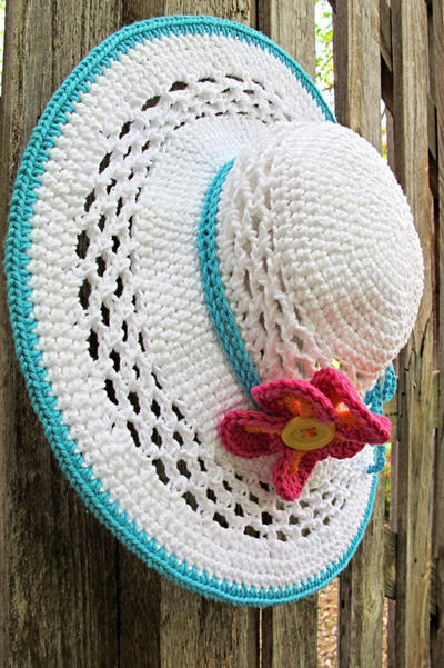 Aloha - a wide brimmed sun hat with flower